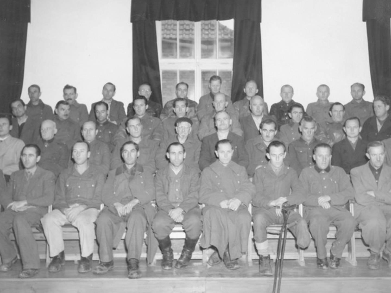 Angeklagte SS-Funktionäre im Dachau Prozess 1945.